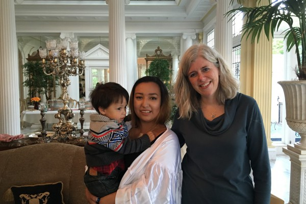 Jennifer Douglas posing with recent graduate Jenny Soto and her two-year-old son.