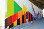 Birdseed Collective recruited local youth to help paint the art installation.   Photo courtesy, Alana Romans