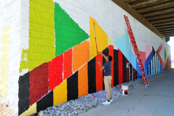 Birdseed Collective recruited local youth to help paint the art installation. | Photo courtesy, Alana Romans