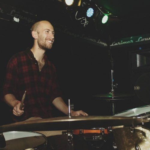 In his spare time, Clayton plays the drums in multiple bands.