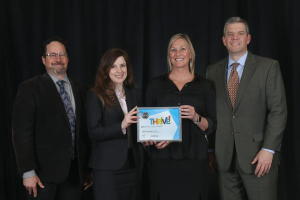 Urban Land Conservancy and FirstBank accept the 2019 Metro Vision Award from the Denver Regional Council of Governments (DRCOG) for the Metro Denver Impact Facility (MDIF). From left: Aaron Miripol, Amber Hills, Christi Smith and Stu Wright.