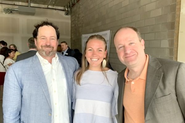 Urban Land Conservancy (ULC) staff with Governor Jared Polis.