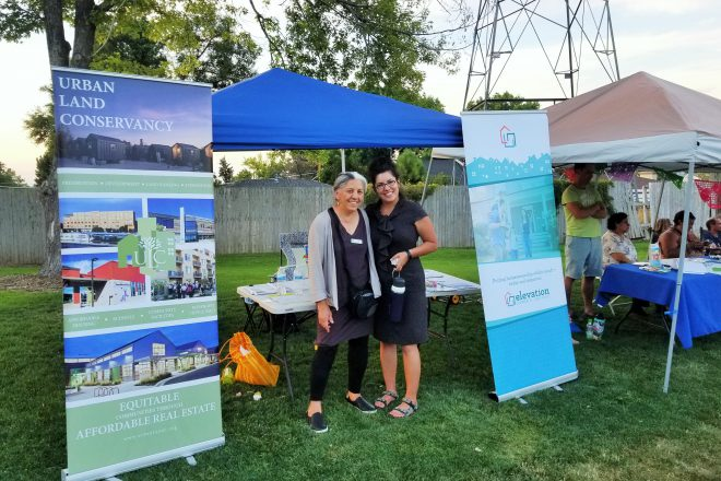 Carmen Atilano of Urban Land Conservancy and Jessica Dominguez of Interfaith Alliance pose for a photo at Westwood's National Night Out event.